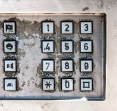 Old payphone keypad, dirty and grunge