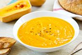 pic of vegetable soup  - Butternut squash soup by loaf of bread - JPG