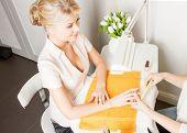 beautiful woman having a manicure at the salon