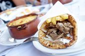 stock photo of gyro  - Plate with Gyros and pot of meat with cheese - JPG
