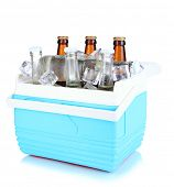Traveling refrigerator with beer bottles and ice cubes isolated on white