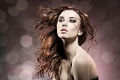 foto of hair motion  - fashion portrait of beuty brunette girl with wavy flying wet hair - JPG