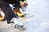 Tying Laces Of Ice Hockey Skates Skating Rink