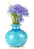 Beautiful bouquet of cornflowers in vase, isolated on white