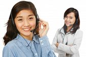 image of filipina  - Two young women wearing headsets  - JPG