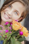 Pretty Young Girl Holding A Flower Bouquet at the Street Market.