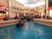 Goldola, River, And Shops Inside The Landmark Venetian Hotel In Las Vegas