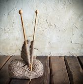 foto of wooden basket  - Balls of yarn and knitting on a wooden table - JPG
