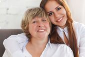Portrait Of A Mature Grandmother And Teen Granddaughter And Teen Granddaughter