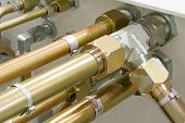 stock photo of hydraulics  - Multiple Hydraulic Tubes and Fittings on Hydraulic Equipment - JPG