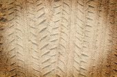 Detail of tyre tracks in sand desert