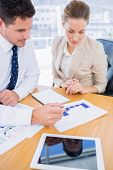 foto of half-dressed  - Smartly dressed young man and woman in a business meeting at office desk - JPG
