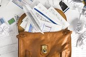 Financial Paperwork Spilling Out Of Briefcase