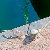 stock photo of bollard  - three ropes tied to a metal bollard in Temo shore - JPG