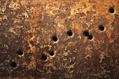 stock photo of gunshot  - Rusty metallic surfaces perforated with bullet holes - JPG
