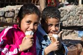DAHAB - JANUARY 23. Local bedouin kids enjoying the pleasures of the western culture in Dahab, Egypt.