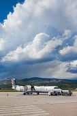 SPLIT, CROATIA - JUN 6: Croatia Airlines Dash 8 Q400 parked on a runway of Split Airport during boar