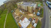 Builders are working on cladding of the building, view from unmanned quadrocopter.