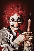 picture of hallucinations  - Crazy medical clown holding oversized syringe filled with blood when curing the sick of paranoia delusions and hallucinations - JPG