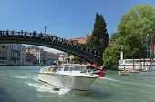 Venice, Veneto, Italy - May 24: Taxi boat driving under Ponte dell'Accademia bridge on Grand Canal. circa May 24, 2011 in Venice, Veneto, Italy