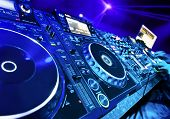 stock photo of mixer  - Dj mixes the track in the nightclub at party - JPG