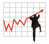 A young businessman climbing up a positive chart. All on white background.