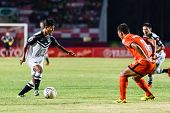 Sisaket Thailand-may 28: Nurul Sriyankem Of Chonburi Fc. (white) Runs For The Ball During Thai Premi