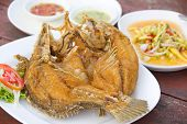 Fried Snapper With Chili Sauce On The Plate