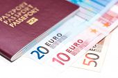 stock photo of spanish money  - European Passport and Euro on white table - JPG