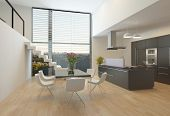Modern kitchen interior with a central hob, wall units, dining table and steps up to a mezzanine wit