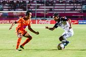 Sisaket Thailand-may 28: Anuwat Nakkasem Of Chonburi Fc. (white) In Action During Thai Premier Leagu