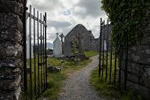 picture of headstones  - graveyard and ruins of the Ballinskelligs Priory on the Kerry Pennisula - JPG