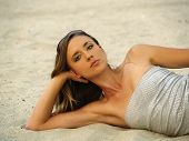 Young Skinny Woman Reclining In Sand Confident