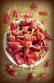 red chili peppers on wooden table