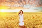 Beautiful young woman in wheat field