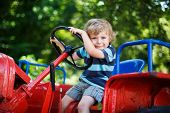 Funny Little Boy Of Three Years Playing On Tractor