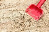 Children's Shovel In The Sandbox.