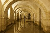 Winchester, Hampshire, UK - May 15, 2014: The flooded Crypt of Winchester Cathedral containing the sculpture