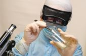 Woman Laboratory Assistant Whit Chemical Glasses
