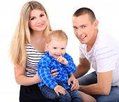 Happy young couple with small baby isolated on white