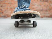 picture of skate board  - boy moves on a skate board in an urban zone - JPG