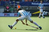 THE HAGUE, NETHERLANDS - JUNE 1: Argentinian player Rey is about tho play the ball during the Hockey