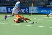 THE HAGUE, NETHERLANDS - JUNE 1: Dutch player Hertzberger is laying on the ground. Brunet is taking over te ball during the Hockey World Cup. NED beats ARG 3-0