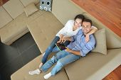 happy young couple at modern home using tablet computer