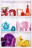 White shelves with colorful things, close-up