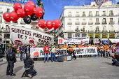 MADRID, SPAIN - OCTOBER 17, 2014: Crowds at Puerta del Sol Plaza protest the privatization of state-owned airport operator Aena Aeropuertos. The plan has met much opposition.
