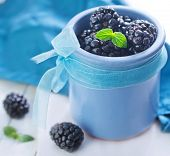 picture of blackberries  - fresh blackberries in the blue bowl on the table - JPG