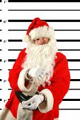 Santa was arrested for being a Bad Boy after getting drunk on elderberry wine left out by the elves. Apparently Elves feel no effect from Elderberry Wine but it looks like Santa sure does.
