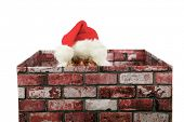 stock photo of christmas claus  - Santa Claus in a Chimney - JPG