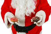 picture of donut  - Santa Claus enjoys fresh baked piping hot donuts left for him as a thank you gift for all the nice presents he brings to good little boys and girls around the world - JPG